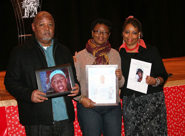 True Vine members who brought pictures of loved ones to the Gun Violence Prevention Sabbath observance. (Photo courtesy of True Vine Ministries)