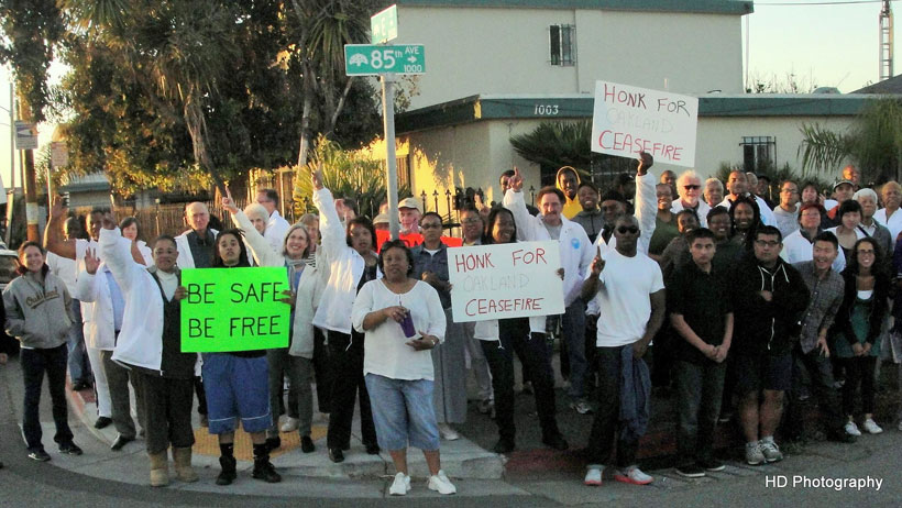 Participants of a Ceasefire night walk in East Oakland. (Photo by Howard Dyckoff)