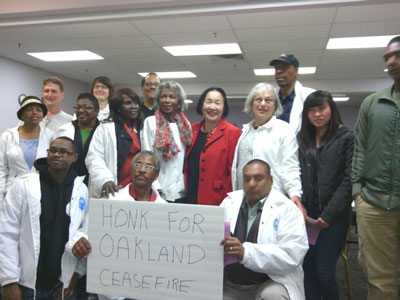 Mayor Jean Quan poses with participants of a Ceasefire night walk after a Friday night route.